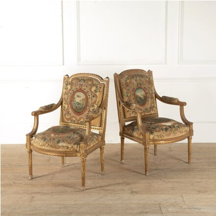 Pair of French Louis XVI Late 19th Century Gilt and Painted Arm Chairs CH8811145