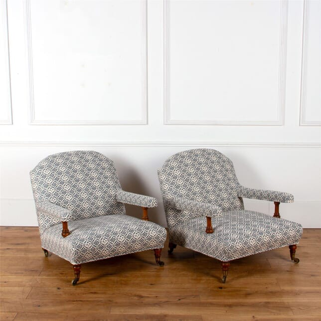 A Matched Pair of 19th Century Howard & Sons Open Arm Armchairs CH107441